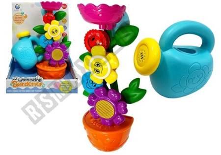 Little Gardener's set. A flower in a pot. Watering can