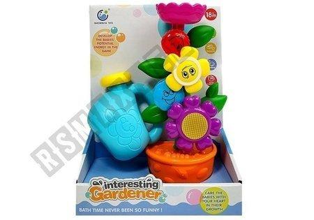 Das Set des kleinen Gärtners. Eine Blume in einem Topf. Gießkanne